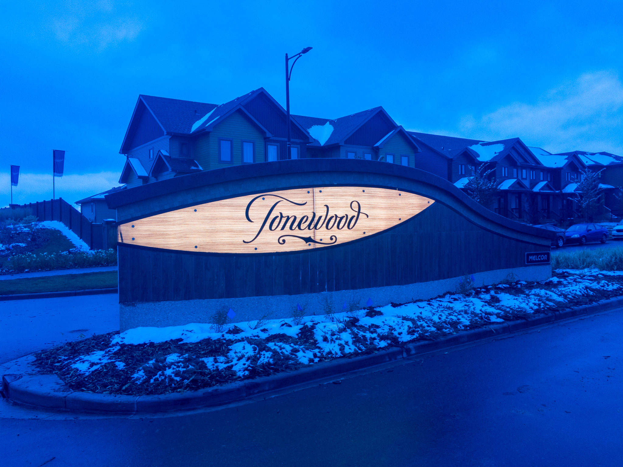 Entrance feature driving into the Tonewood Community, lit up at night