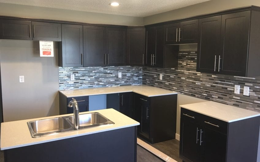 Brand new single family, rear detached home in Spruce Grove, featuring three bedrooms, two and a half bathrooms, located in the community of Tonewood.