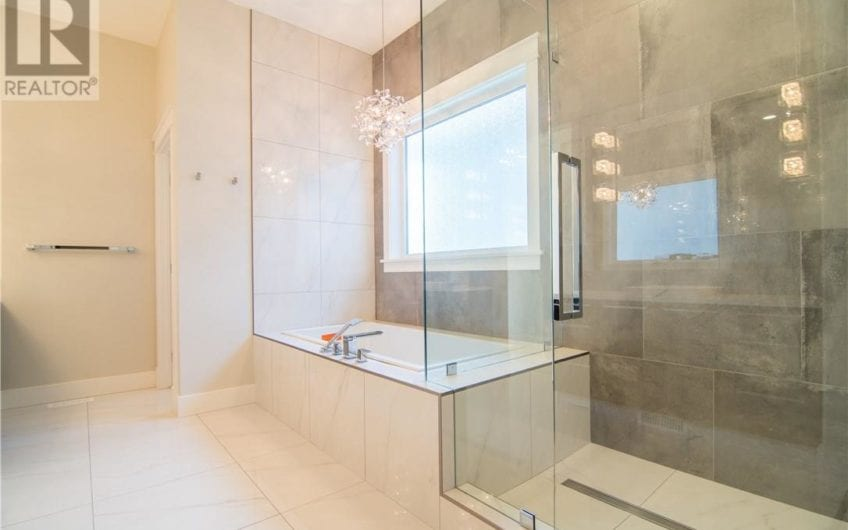 Gorgeous, modern, 3700 sq ft quick possession home with three bedrooms and two and a half bathrooms, located in the community of Vanier Woods East, in Red Deer, AB.